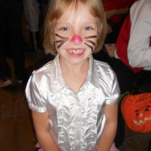 Natalie's face painted like a cat