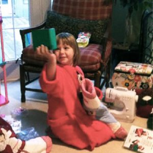 Natalie opens gifts on Christmas while being treated for DIPG