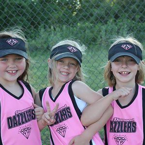 Natalie, DIPG patient, with her friends at softball